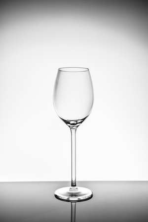 Wineglass on the light background.. Fine cristal glassware concept. Vertical