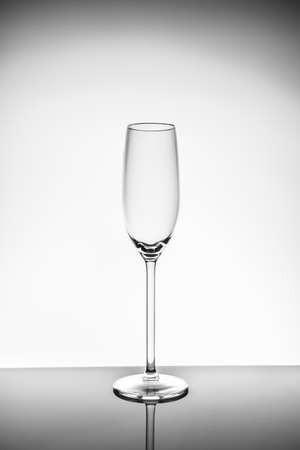 Champagne glass on the light background.. Fine cristal glassware concept. Vertical