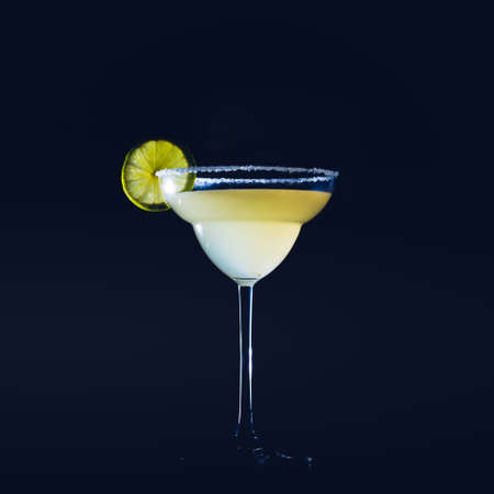 Classic daiquiri on the dark background.  Luxury craft drink concept. Square, toned image