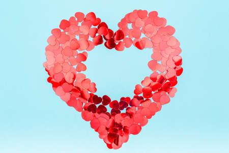 Heart shaped glitter confetti. Valentine day concept. Trendy minimalistic flat lay design background. Horizontal, surreal toning, glitch effect