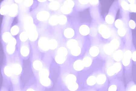 Holiday background with white blurred defocused bokeh. Christmas background. Horizontal. Lilac tone. Ultra violet tone, color of the year 2018