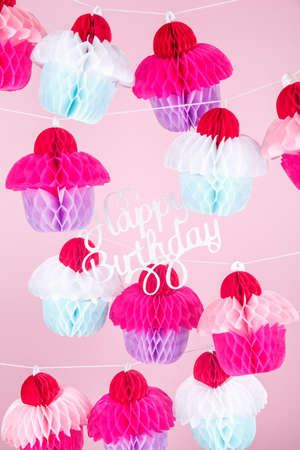 Paper cupcakes celebration decoration with happy birthday lettering. Holiday party concept Vertical 写真素材