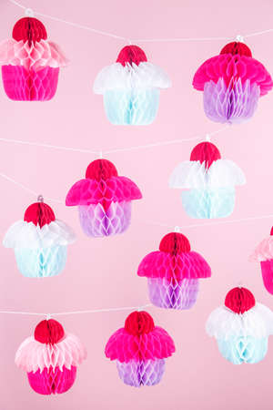 Paper cupcakes celebration decoration. Holiday party concept. Vertical