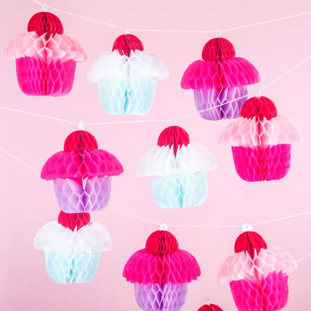 Paper cupcakes celebration decoration. Holiday party concept. Square