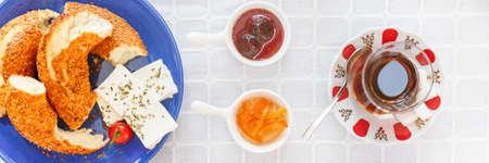 Turkish tea, Cheese, Honey, Jam, Simit.  Authentic turkish breakfast. Local cuisine concept. Soft focus. Horizontal, wide format, banner