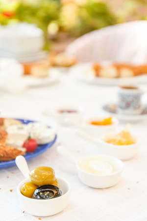 Coffee, Cheese, Honey, Jam,  Olives, Simit. Authentic turkish breakfast. Local cuisine concept. Soft focus. Vertical Stock Photo
