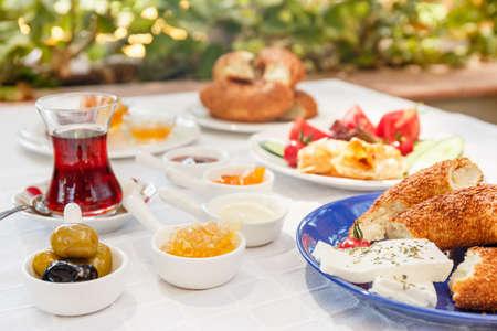 Turkish tea, Cheese, Honey, Jam,  Olives, Simit. Authentic turkish breakfast. Local cuisine concept. Soft focus. Horizontal
