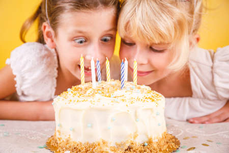 Girls excited by birthday cake. Birthday party celebration concept. Horizontal