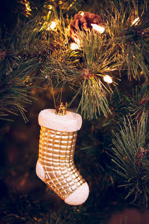 Seasonal background with Christmas toy on the tree. Celebration concept. Soft focus. Vertical