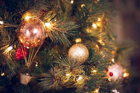 Seasonal background with Christmas toys on the tree. Celebration concept. Soft focus. Horizontal Stock Photo