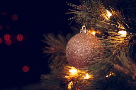 Seasonal background with Christmas toy on the tree. Celebration concept. Soft focus. Horizontal