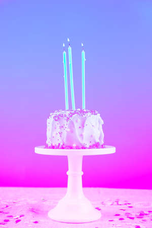 Birthday cake with candles. Birthday party celebration concept. Vertical. Modern surreal pop art toning, creative reality concept Stock Photo
