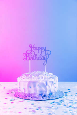 Birthday cake with golden topper. Birthday party celebration concept. Vertical. Modern surreal pop art toning, creative reality concept Stock Photo