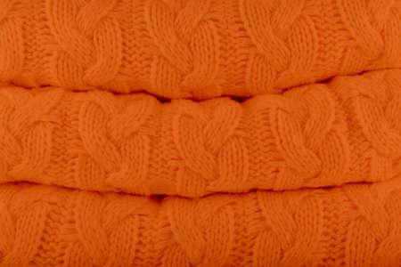 Russet Orange Pantone fashion colors autumn-winter 2018-2019 knits pile. Warm cozy home and fashion colors concept. Horizontal