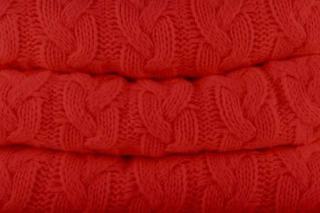 Valiant Poppy Pantone fashion colors autumn-winter 2018-2019 knits pile. Warm cozy home and fashion colors concept. Horizontal