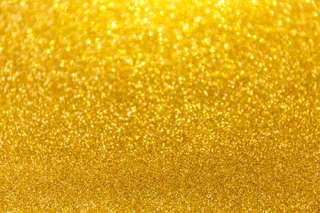 Blurred glitter golden background for holiday and any project. Shallow depth of field. Horizontal Imagens