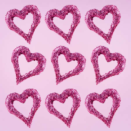 Glitter hearts on pink background.  Valentines day and love concept. Square Stock Photo