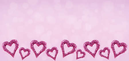 Glitter hearts with bokeh on pink background.  Valentines day and love concept. Horizontal wide screen banner format
