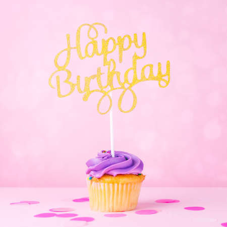 Creative pastel fantasy holiday card with cupcake and happy birthday topper on bokeh backdrop. Baby shower, birthday, celebration concept. Square