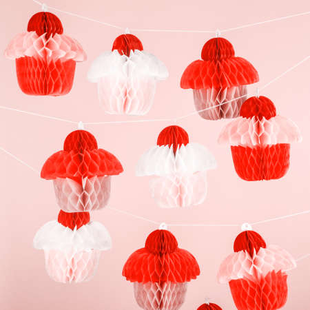 Paper cupcakes celebration decoration. Holiday party concept. Square. Living coral theme - color of the year 2019