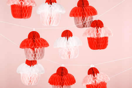 Paper cupcakes celebration decoration. Holiday party concept. Horizontal. Living coral theme - color of the year 2019