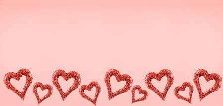 Glitter hearts on pink background.  Valentines day and love concept. Horizontal wide screen banner format. Living coral theme - color of the year 2019 Zdjęcie Seryjne