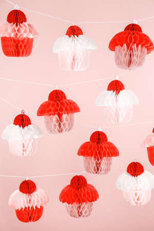 Paper cupcakes celebration decoration. Holiday party concept. Vertical. Living coral theme - color of the year 2019