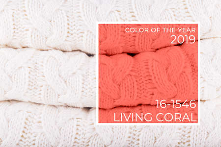2019 color of the year Living coral knits pile. Warm cozy home and fashion colors concept. Horizontal