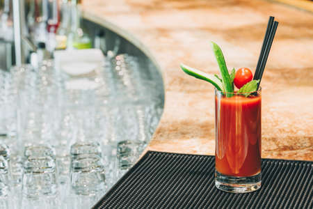 Bloody Mary cocktail at the bar stand. Luxury vacation concept. Horizontal Фото со стока