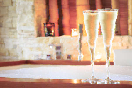 Two glasses of champagne near jacuzzi. Valentines background. Romance concept. Horizontal. Glitch effect, colorful disruptive Standard-Bild - 116997561