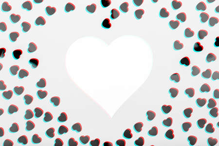 White heart with glitter heart confetti. Valentine day concept. Trendy minimalistic flat lay design background. Horizontal, heart shape mockup. Glitch effect, black and white Standard-Bild - 116997524