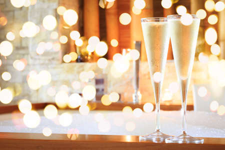 Two glasses of champagne near jacuzzi. Valentines background. Romance concept. Horizontal, bold festive bokeh Standard-Bild - 116997543