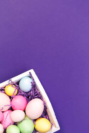 Multicolor eggs in a white tray. Creative Easter concept. Modern solid ultra violet background.  Color of the year inspired. Standard-Bild - 120552929