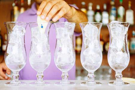 Bartender makes craft cocktails near the pool. Vacation, summer, holiday, luxury resort concept. Horizontal Standard-Bild - 120552934
