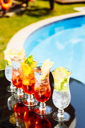 Craft cocktails near the pool. Vacation, summer, holiday, luxury resort concept. Vertical Standard-Bild - 120552941