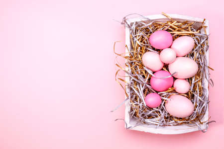 Eggs in a white tray. Creative Easter concept. Modern solid pink background. Horizontal Standard-Bild - 120552947