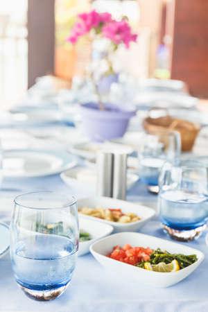 Varioius meze starters in an outdoor greek restaurant. Healthy vegetarian snacks. Local mediterranean cuisine Standard-Bild - 122380231