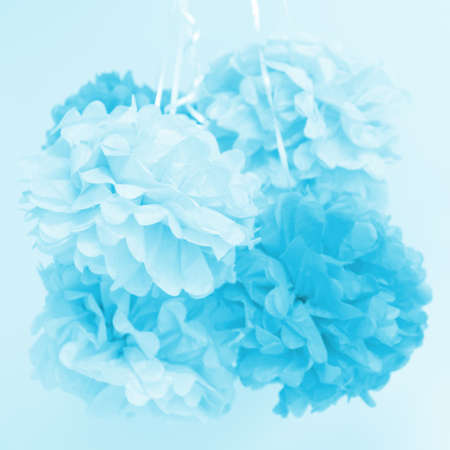 Paper flowers at the boy baby shower party. Baby shower celebration concept. Festive party background. Square Standard-Bild - 122380310
