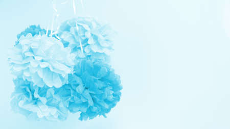 Paper flowers at the boy baby shower party. Baby shower celebration concept. Festive party background. Horizontal, wide screen format Standard-Bild - 122380312