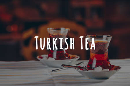 Turkish tea in the restaurant. Turkish cuisine and travel concept. Horizontal. Turkish tea wording