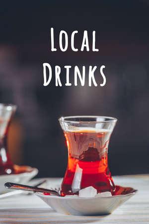 Turkish tea in the restaurant. Turkish cuisine and travel concept. Vertical. Lopcal drinks wording Imagens - 126500792