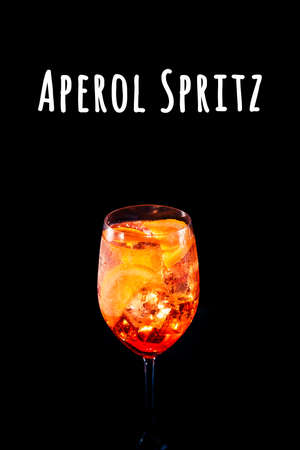 Stylish alcoholic trendy cocktail with orange slice on black background. Vertical photo.