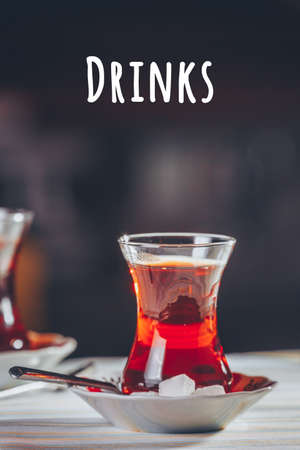 Turkish tea in the restaurant. Turkish cuisine and travel concept. Vertical. Drinks wording