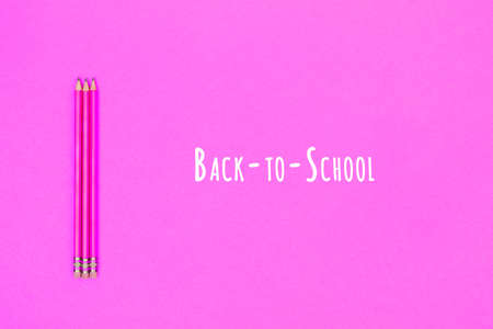 Pencils on a neon pink background. Back to school concept. Horizontal Imagens