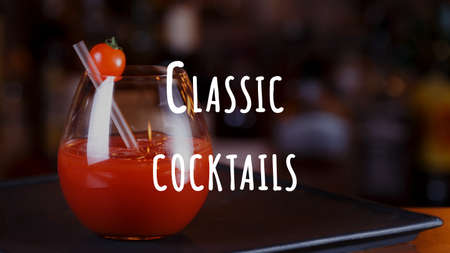 Bloody Mary or Ceasar cocktail at the bar counter. Party and vacation concept. Horizontal, wide screen format, close up. Classic cocktails wording Imagens