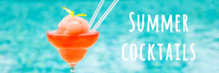 Frozen strawberry margarita cocktail at the edge of outdoor resort pool. Concept of luxury vacation. Horizontal, wide screen banner. Bar menu wording