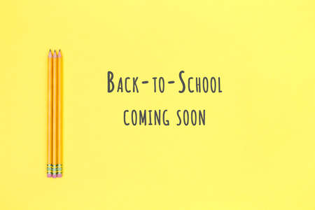 Pencils on a yellow background. Back to school concept. Horizontal. Back to school wording