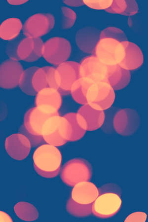 Classic blue background with soft pastel bokeh lights.Holiday, Christmas and New Year background. Ideal to layer with any design. Horizontal