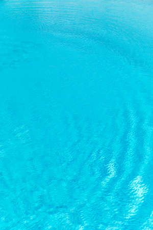 Surface of blue shining swimming pool water ripple. Perfect as a background for summer, vacation, calmness, serenity or any other idea. Banco de Imagens