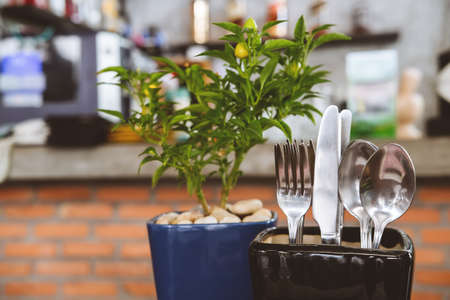 Cutlery set creatively placed on the restaurant table. Modern design hipster concept, soft focus